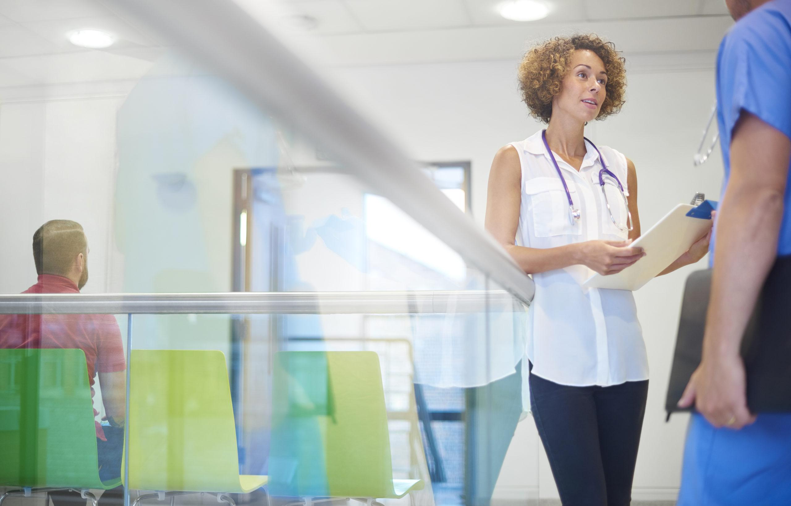 Doctor Speaking to Nurse